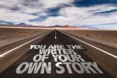 You Are The Writer Of Your Own Story written on desert road
